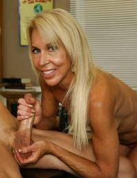 Lascivious mature blonde gives a sensual handjob and gets bukkaked