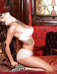 Big tits brunette babe Meghan Nicole shows off in white lingerie