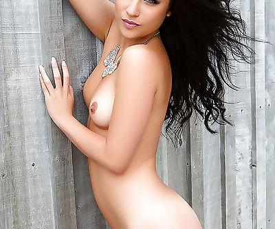 Brunette Euro babe Elle Georgia freeing tiny tits for centerfold spread