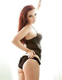 Fantastic busty redhead babe Elizabeth Marxs in gorgeous lingerie