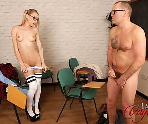 Young Chloe Toy in thigh socks and pigtails baring her tiny ass in class
