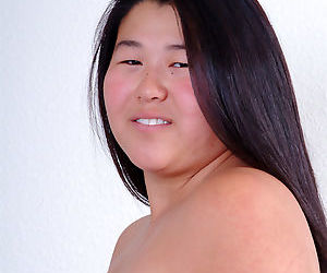 Chubby Asian first timer baring small boobs while shedding cheer uniform