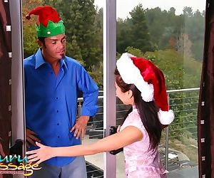 Fully clothed Asian female with crossed legs entertains man at Christmas time