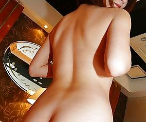 Asian lady Asami Usui undressing and exposing her puristic pussy alongside button apropos up