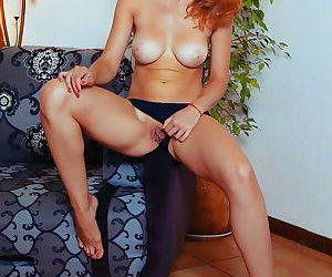 Tanned sexy redhead Kika reveals firm nice tits & spreads pussy with fingers
