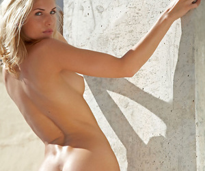 Nude Euro model Iveta B showing off great legs and tight ass beside pool