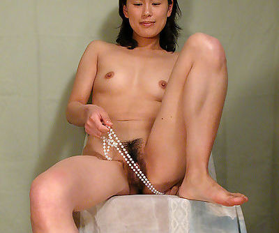 Asian first timer Miki sliding panties aside for spreading of hairy cunt