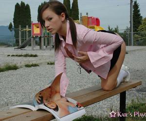 Horny schoolgirl Kate spreading in white panties & socks to masturbate outside