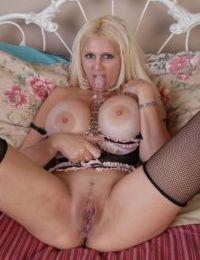 Mature blonde Kayla Kupcakes baring her huge knockers and masturbating