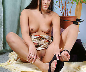 Amateur Asian babe with small tits and pierced nipples spreading bald pussy