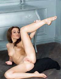 Hot brunette Nikia peels off her tight dress to spread showing bald pussy