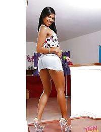 Dark haired brunette teen Emy Reyes is demonstrating her tight cunt