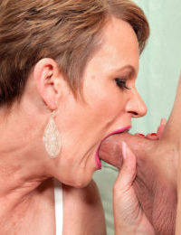 Mature chick in stockings Marla Jones gets pussy pleased by a younger dude
