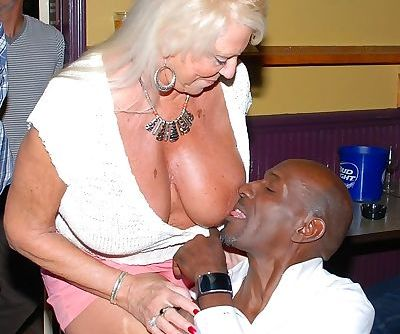 Horny granny enjoying some interracial sex fun at a steamy swingers orgy