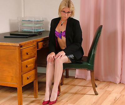 Clothed chick with blonde hair and long legs Charlene posing