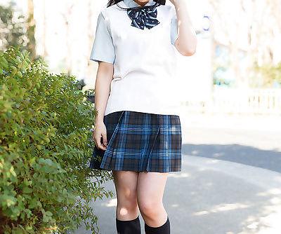 Horny Asian schoolgirl lifts up her skirt and masturbates