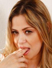 Aged Latina chick Gabriela Mendoza revealing nice melons before masturbating
