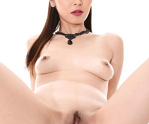 Beautiful Asian female Marica Hase works clear of her black dress to pose nude