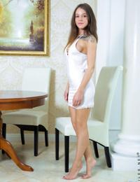 Petite teen Sveta teasing in her amazing white dress at the table