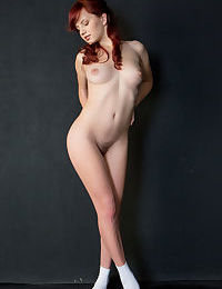 Cute redhead Solana disrobes gracefully to show her sweet nipples