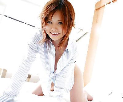 Naughty asian coed Hitomi Yoshino showcasing her jugs and hairy cunt
