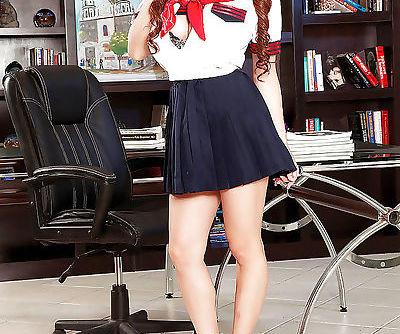 Asian coed solo girl Hitomi freeing big teen tits from schoolgirl uniform