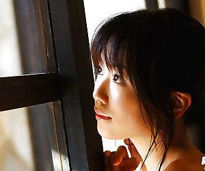 Sexy asian babe Saki Ninomiya showcasing her perky tits and unshaven cunt