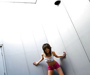 Seductive asian babe Azumi Harusaki posing in pink shorts and tiny top