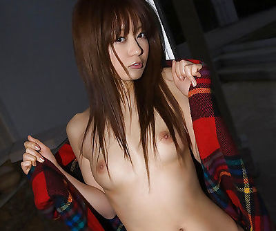 Arousing asian coed with shaggy cunt stripping off her clothes