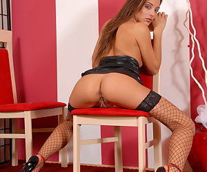 Young babe in fishnet stockings Dominika entrances with the view of her snatch