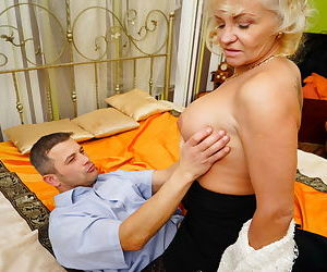 Hot granny strips to her black stocking for hot younger man doggystyle fucking