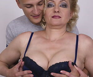 Older blonde cougar gets her tits fondles and sucked by her young boy toy