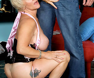 Short haired granny Destiny Anne seduces a younger guy with her big tits out