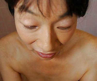 Tiny tits Asian milf Chie Kaneko dose handjob to her man in shower