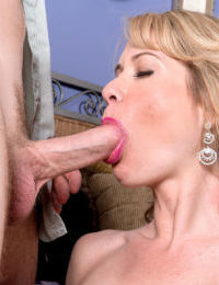 Older blonde lady Desiree Dalton seduces her young lover in sexy lingerie