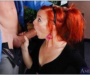 Young ginger-haired porn star Dani Jensen riding a huge cock