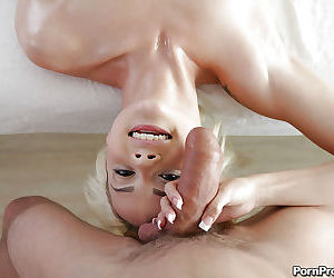 Young blonde girl Elsa Jean giving blowjob on massage table