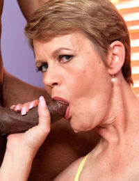 Short haired older broad Marla Jones sucks the sperm out of black mans cock