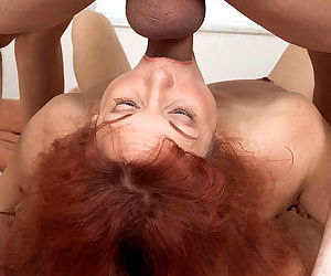 Redheaded grandma Angie Summers deepthroats a cock while giving a blowjob