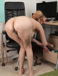 Mature slut with hairy cunt rides a dildo dong in the office in a reality vid
