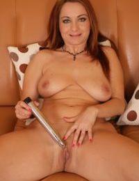 Older Euro lady Jessica Red baring big boobs before masturbating pussy