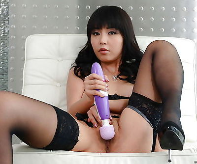 Cute Asian babe Marica Hase takes vibrator and fingers to pussy
