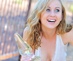 Horny blonde girl lowers her pussy on to a big dildo on the front walkway