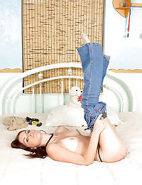 Michelle Peters takes jeans off and dildoes her tattooed pussy