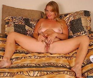 Mature blonde Vickie toys saggy boobs and vagina with sex toy
