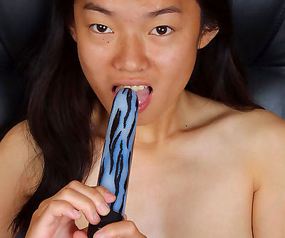Petite Asian chick Tiffany using sex toy to masturbate hairy pussy