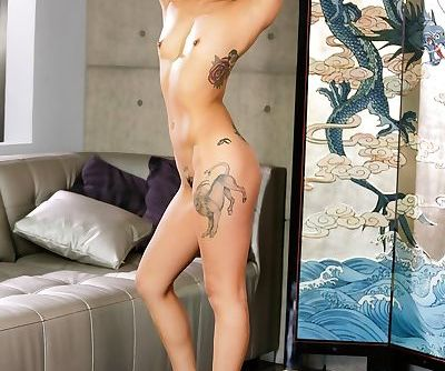Tattooed Asian beauty Saya Song rides a rock hard white penis in high heels