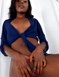 Mature black woman with small boobs sliding skirt over tight ass