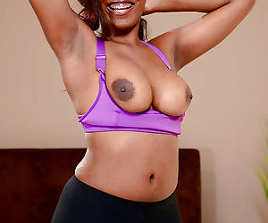 Young black girl Daya Knight peels off sports bra and yoga pants to pose nude