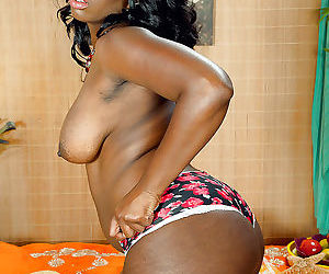 Black solo girl Mia Milan showing off big booty during panty removal